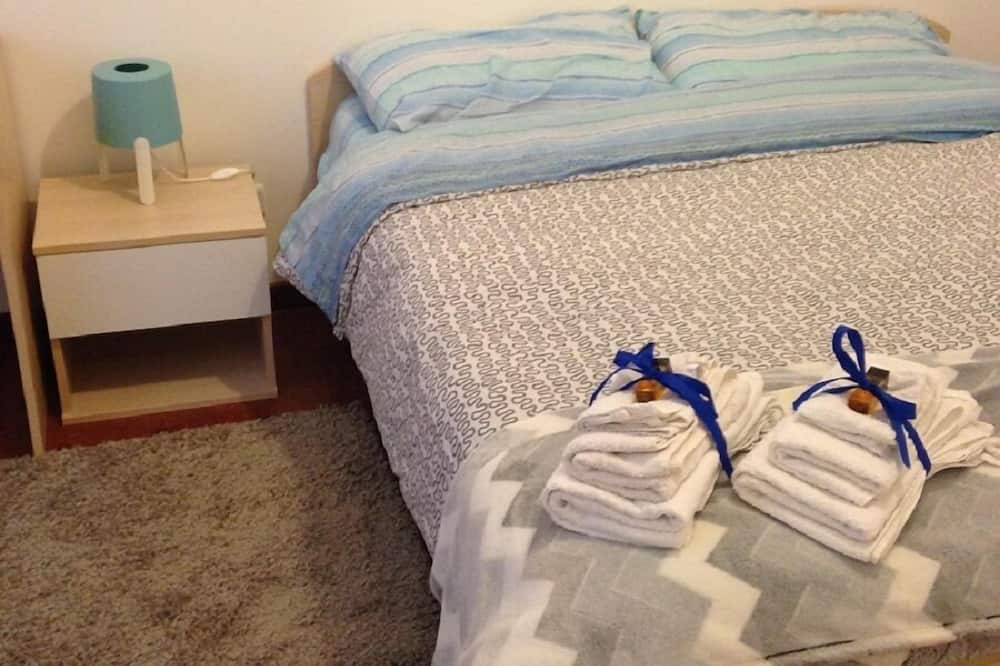 Habitación con 1 cama doble o 2 individuales, baño compartido - Imagen destacada