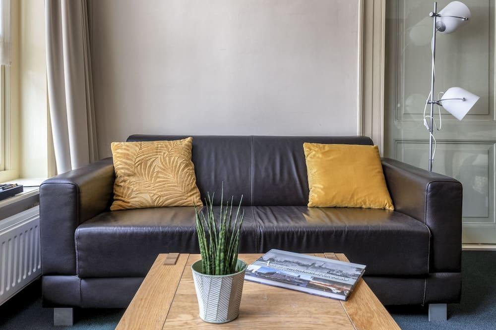 Habitación Deluxe doble, 1 cama de matrimonio, baño compartido - Sala de estar