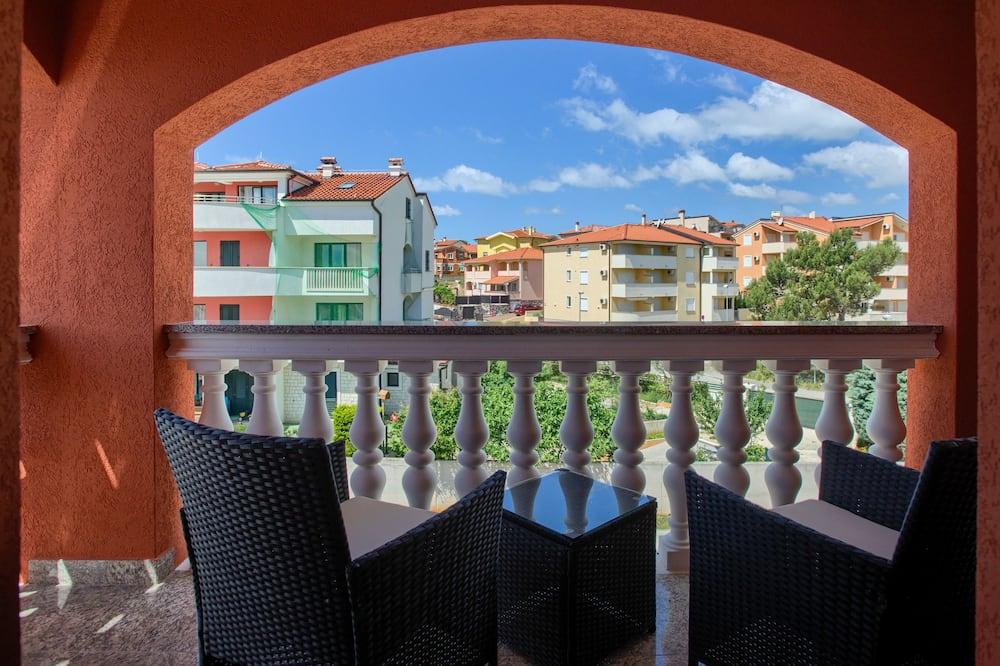 Deluxe-Zimmer, Mehrere Betten, Balkon, Stadtblick - Balkon