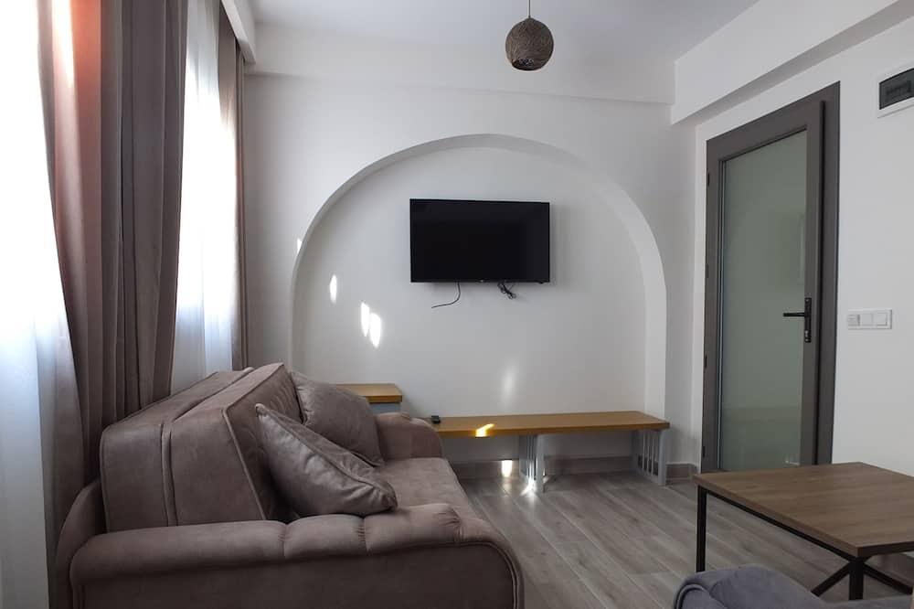 Habitación cuádruple Confort, frente al mar - Sala de estar