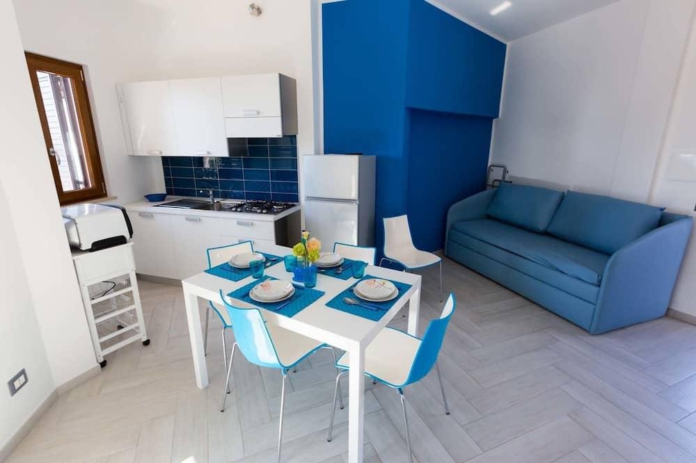 Deluxe-Apartment, 1 Schlafzimmer, Meerblick - Wohnbereich