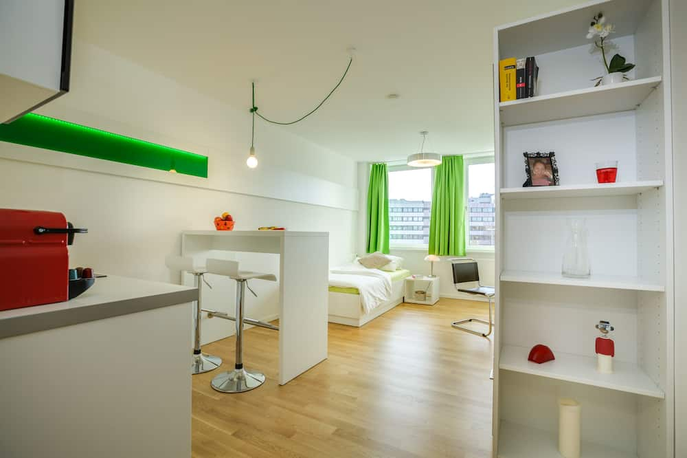 Cosy Apartment - منطقة المعيشة