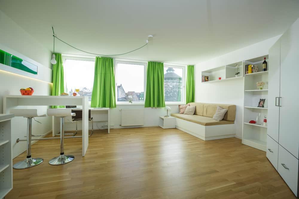Comfy Apartment - منطقة المعيشة