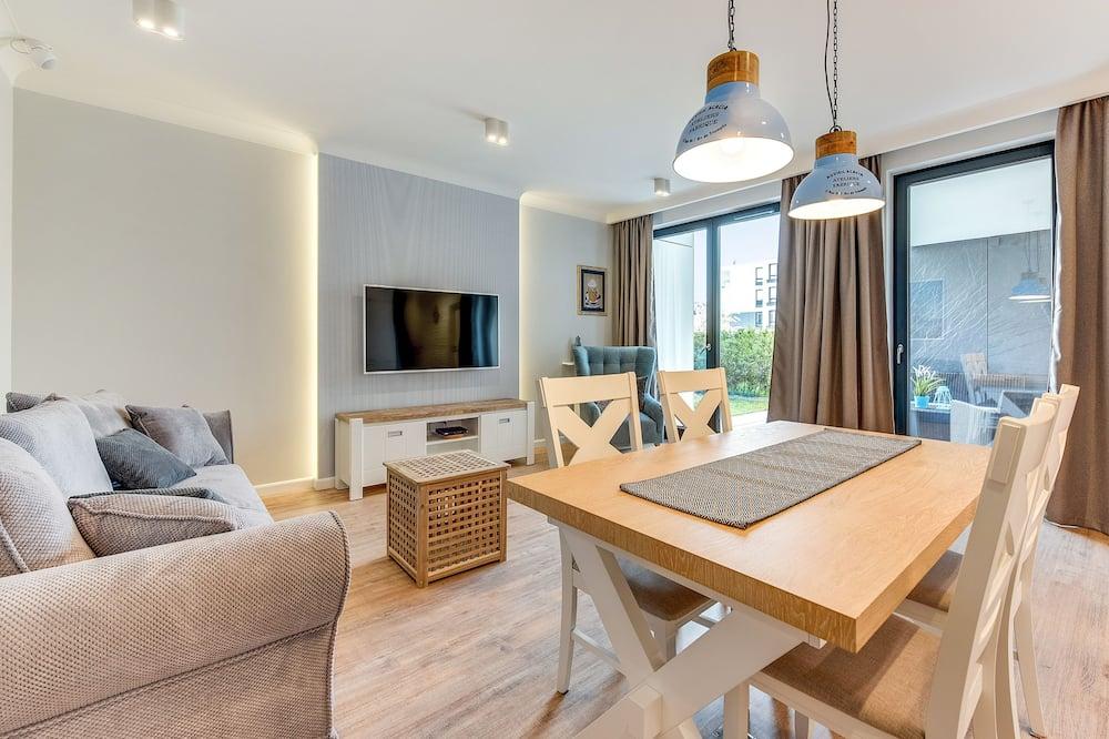 Апартаменти «Делюкс», 1 ліжко «квін-сайз» та розкладний диван (Okrzei 21A/4) - Вітальня