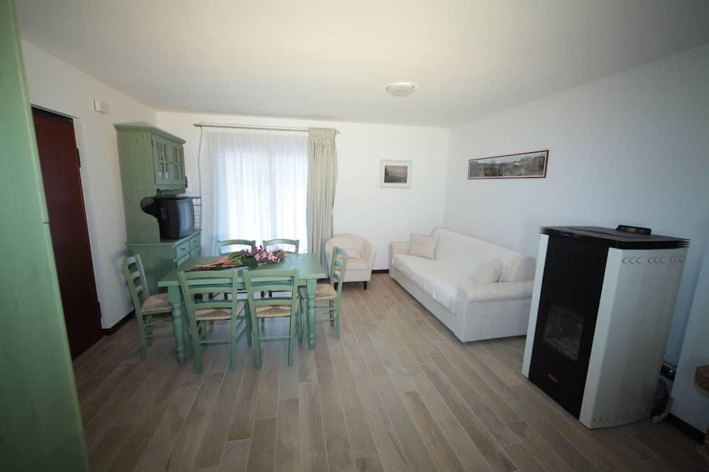 Апартаменты, 2 спальни (Cellino) - Зона гостиной