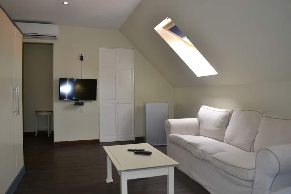 Phòng 4 Deluxe, 2 giường đôi - Khu phòng khách