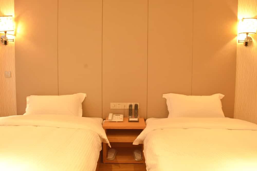 Standartinio tipo dvivietis kambarys (2 viengulės lovos) - Svetainė