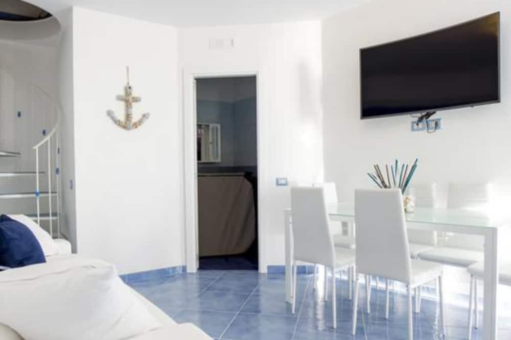 Appartement Exclusif, 2 chambres, vue mer - Coin séjour