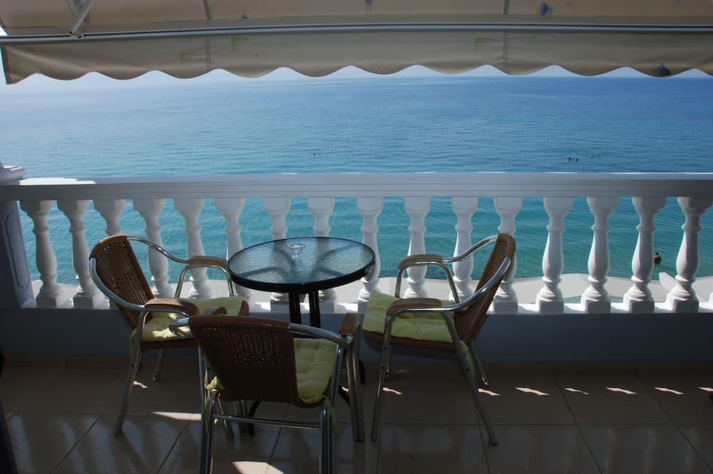 Habitación cuádruple, vista a la playa - Balcón