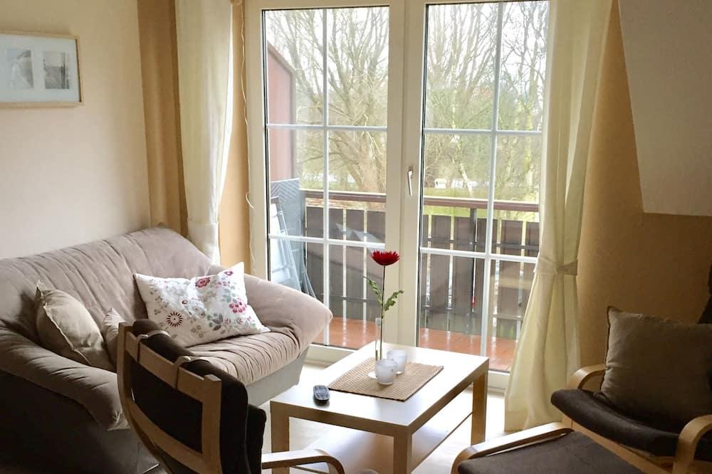 Departamento Premium, Varias camas, balcón - Sala de estar