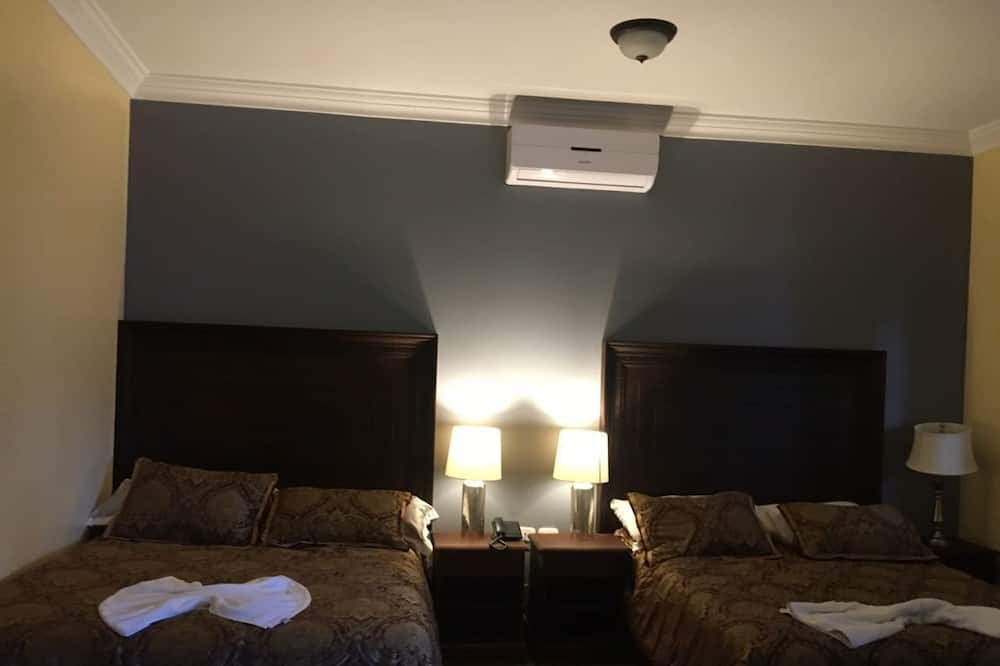 Liukso klasės dvivietis kambarys, Kelios lovos, Nerūkantiesiems - Svečių kambarys