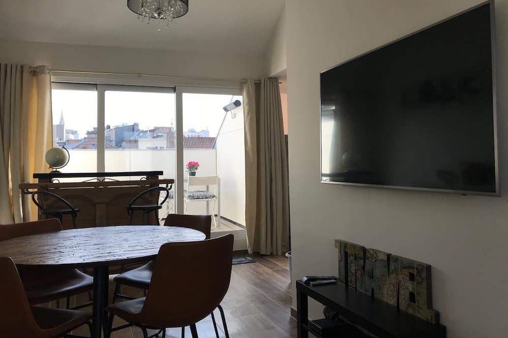 Deluxe studio suite, 1 slaapkamer, Uitzicht op de stad - Woonruimte