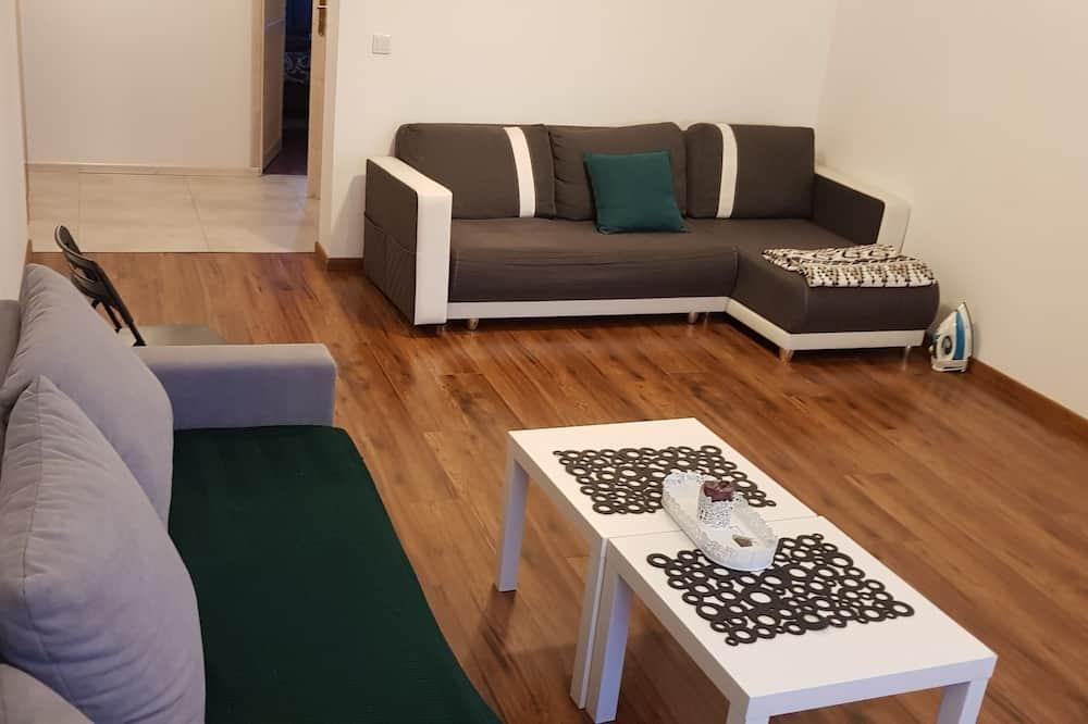 Augšstāva ģimenes numurs, divas guļamistabas - Dzīvojamā istaba