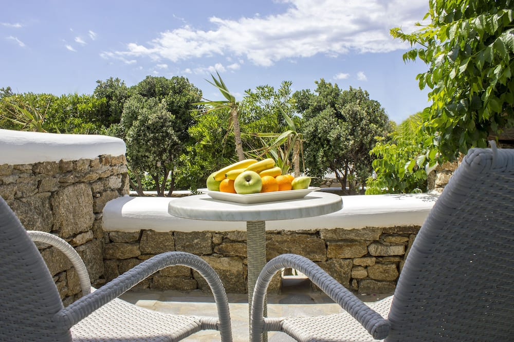 Izba typu Basic s dvojlôžkom alebo oddelenými lôžkami, výhľad na záhradu - Balkón