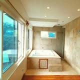 Business tuba, 1 magamistoaga, vanniga, vaade aeda - Mullivann