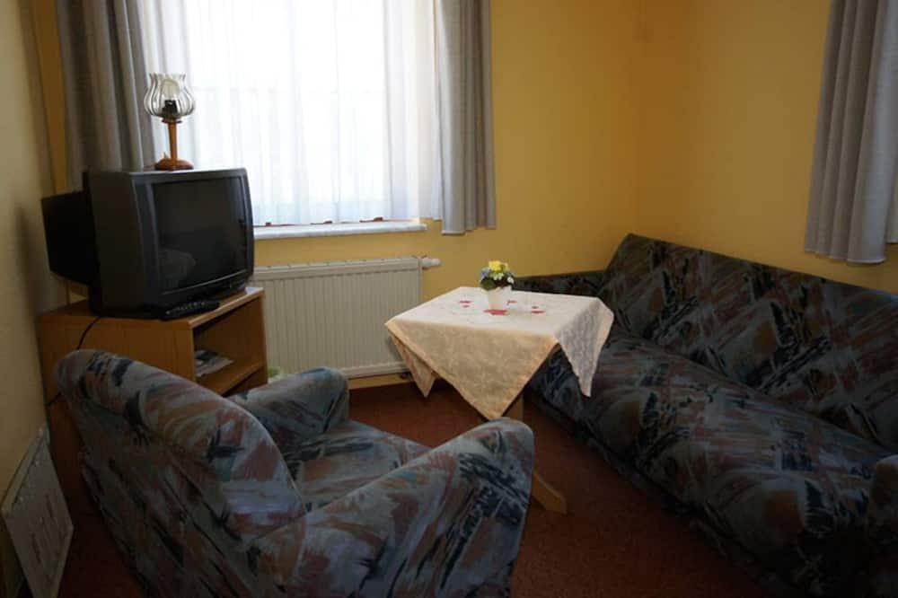 Apartmán (A) - Obývací pokoj