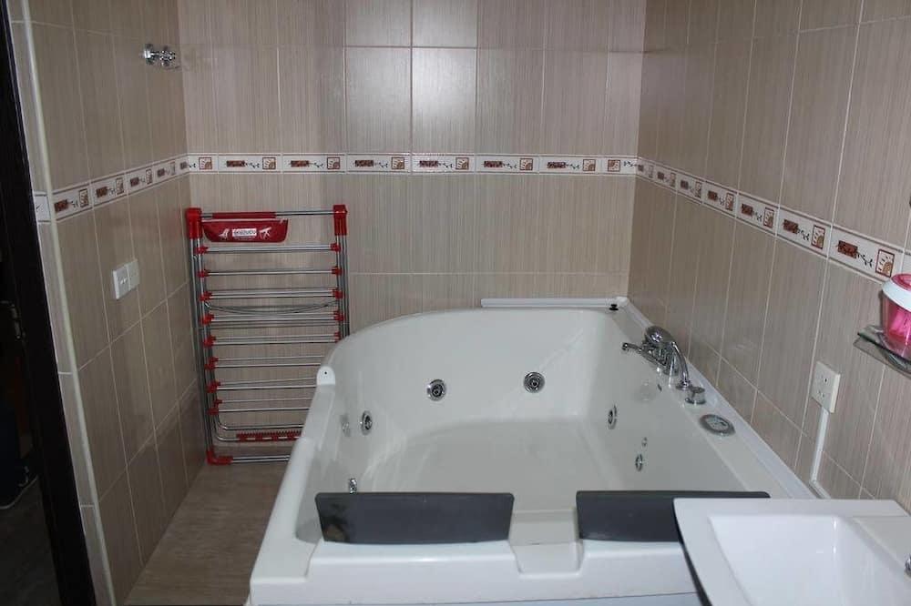 Suite familiar, Varias camas - Baño