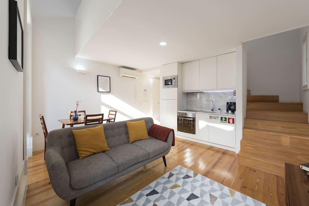 Standaard suite, 1 slaapkamer, op tussenverdieping - Woonkamer