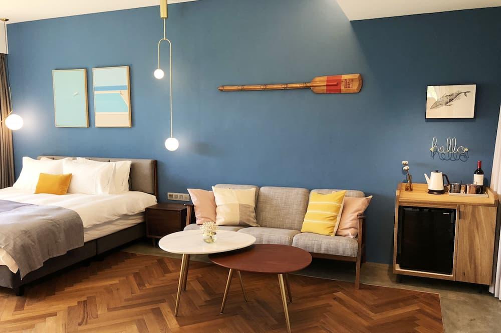 Luxe tweepersoonskamer - Woonruimte