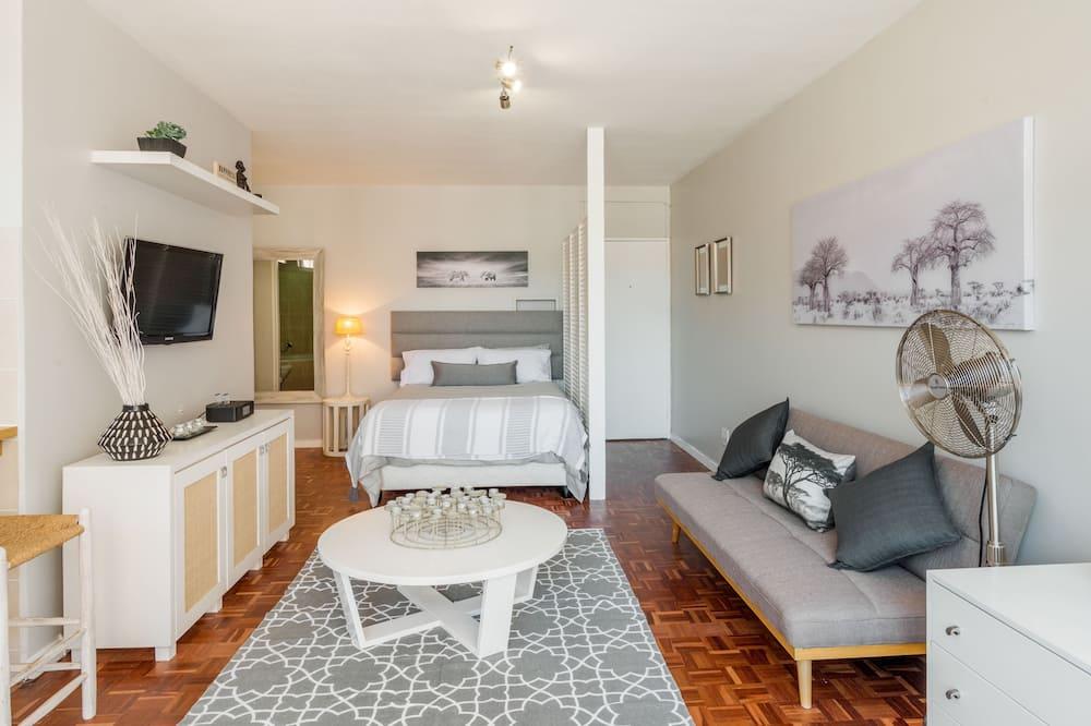 Design Studio Suite, 1 Bedroom, Balcony, Mountain View - Living Area