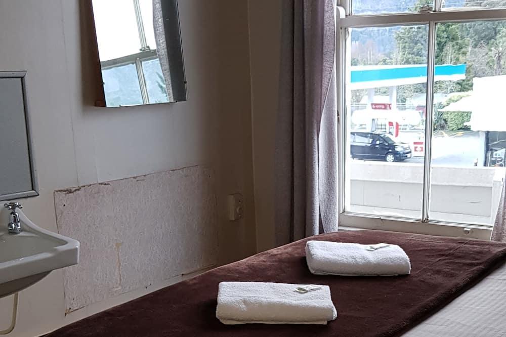 Pokoj Economy s dvojlůžkem, dvojlůžko nebo dvě jednolůžka - Obývací prostor