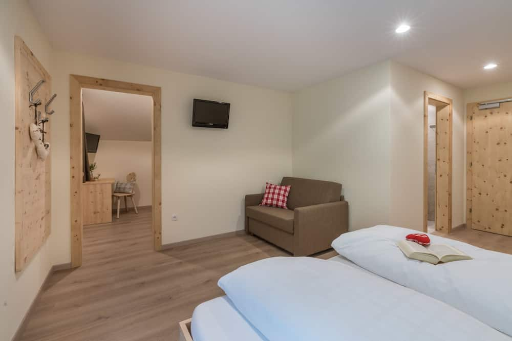 Family Quadruple Room, Balcony - Living Area