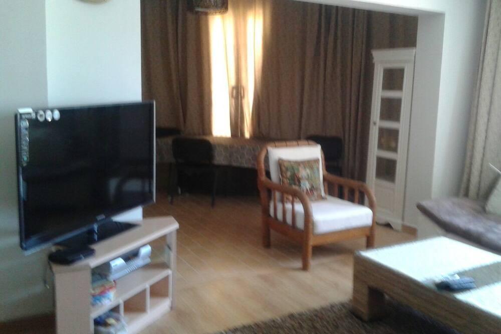 Departamento Grand, 3 habitaciones, vista al jardín - Sala de estar