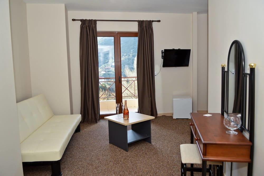 Luksusa numurs, divas guļamistabas, kamīns, skats uz kalniem - Dzīvojamā zona