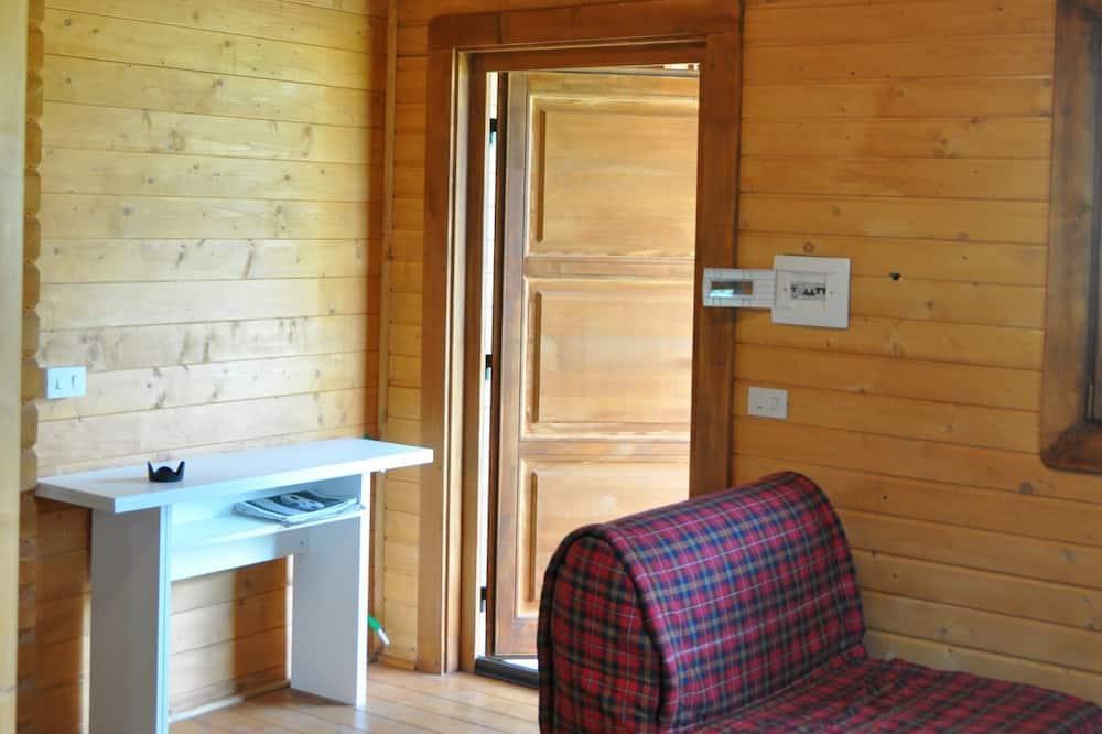 Čtyřlůžkový pokoj, výhled na hory - Obývací prostor