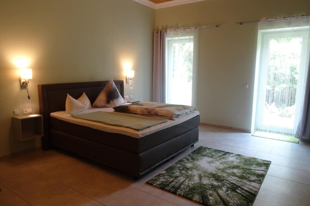 Suite monolocale, vista giardino - Area soggiorno