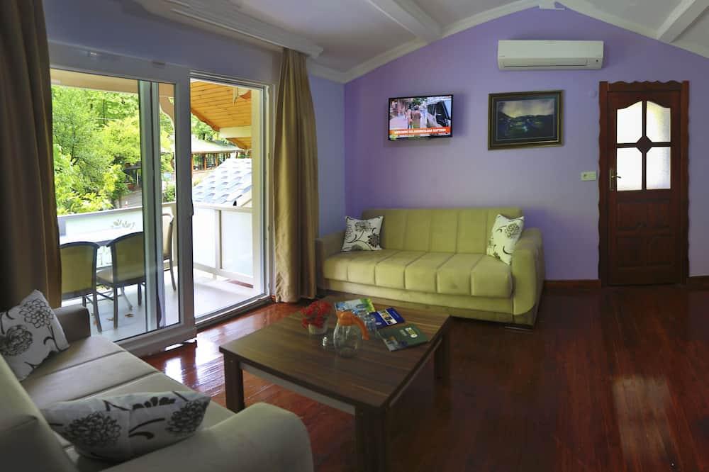 Family Δωμάτιο, Θέα στον Κήπο - Περιοχή καθιστικού
