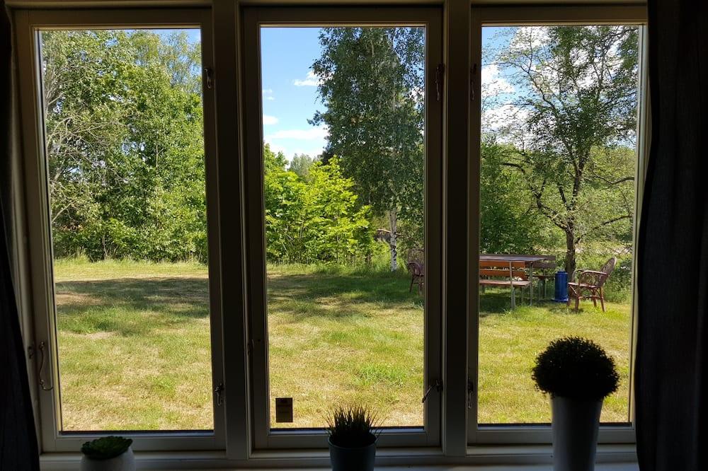 Vierpersoonskamer, gemeenschappelijke badkamer, uitzicht op tuin (Annexet) - Uitzicht op tuin