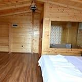 Poilsio namelis, 1 standartinė dvigulė lova, vaizdas į jūrą - Svetainės zona