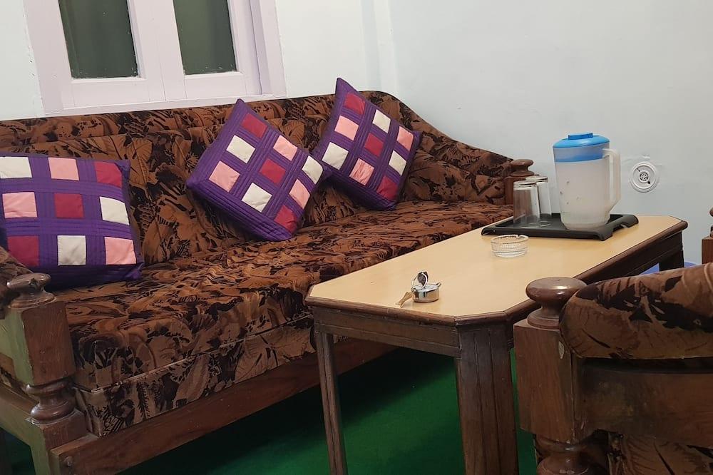 Deluxe-værelse - 1 kingsize-seng - balkon - søudsigt - Stue