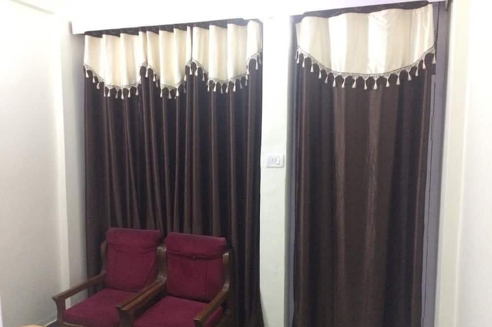 Deluxe-værelse - 1 kingsize-seng - balkon - søudsigt - Opholdsområde