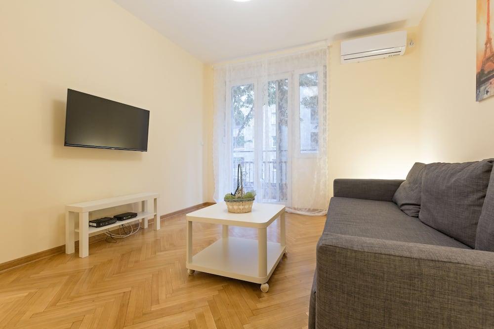 Apartament typu Deluxe, Łóżko queen - Salon