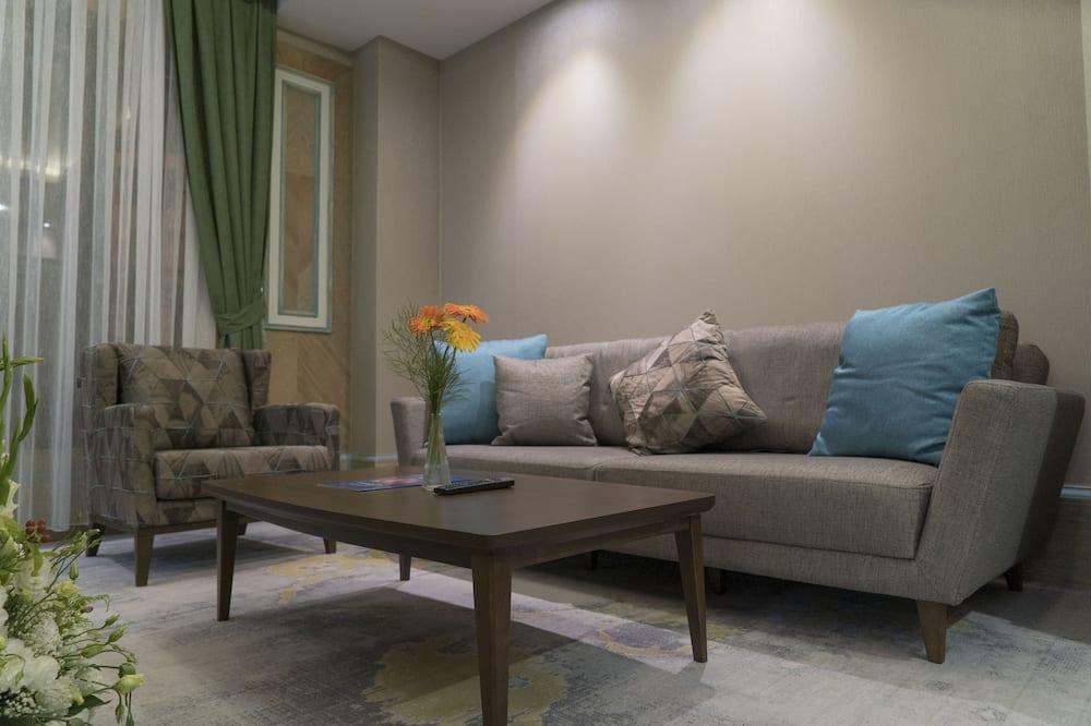 Suite Junior, 1 Tempat Tidur King dengan tempat tidur Sofa - Ruang Keluarga