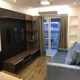 Deluxe apartman, 1 queen size krevet, balkon, djelomičan pogled na ocean - Dnevna soba
