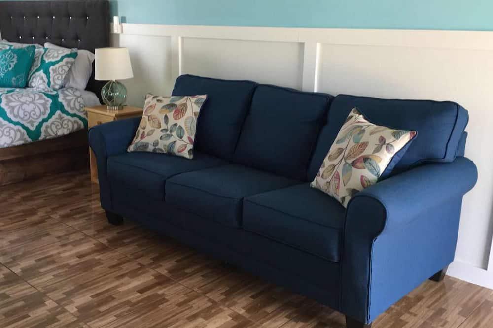 Numeris, 1 labai didelė dvigulė lova ir sofa-lova, Nerūkantiesiems, vaizdas į jūrą - Svetainės zona