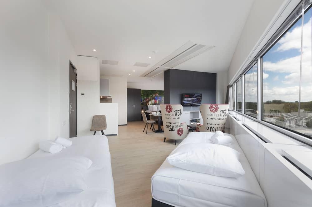 Chambre Quadruple Deluxe, plusieurs lits, non-fumeurs, cuisine - Coin séjour