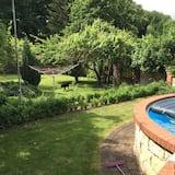 Townhouse Keluarga, akses ke kolam renang, area taman - Pemandangan Kebun