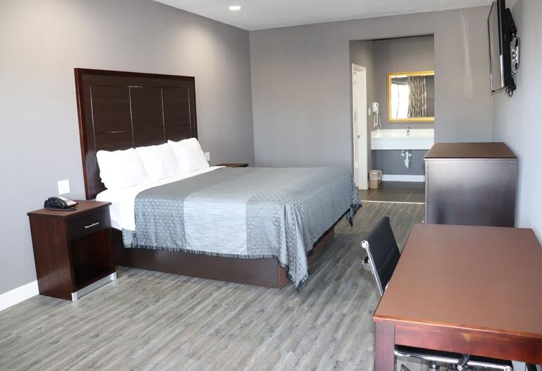 แอตแลนติส อินน์แอนด์สวีทส์, ฮูสตัน, ห้องสแตนดาร์ด, เตียงคิงไซส์ 1 เตียง, สูบบุหรี่ได้, ห้องพัก
