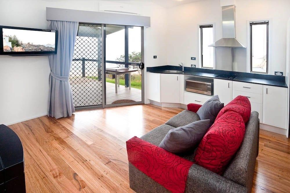 Honeymoon suite, 1 kingsize bed, bubbelbad, Uitzicht op het strand - Woonkamer