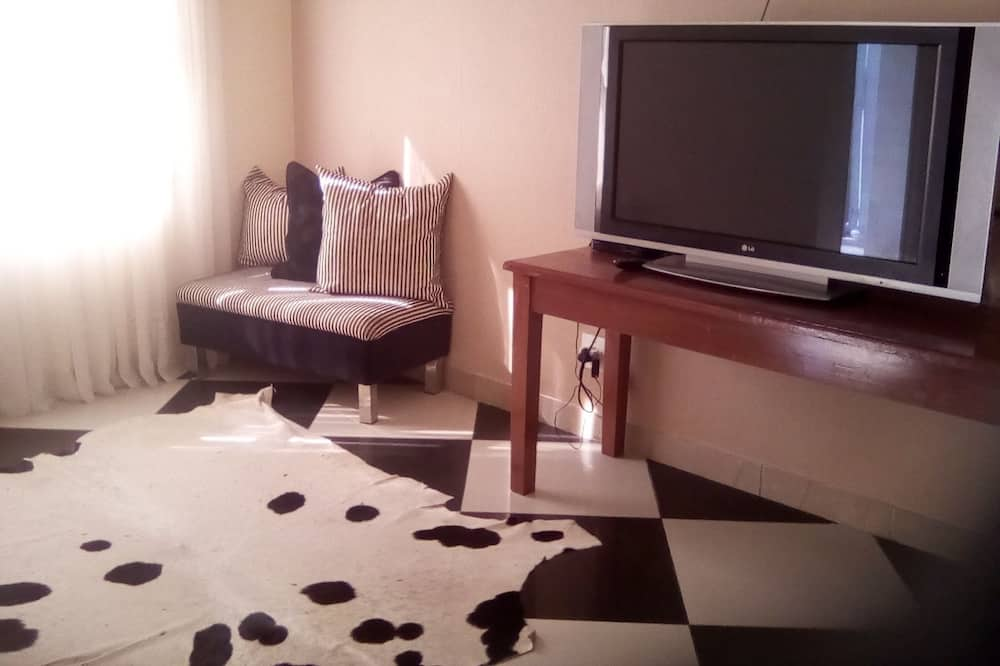 Family Quadruple Room, 2 Double Beds, Non Smoking - Living Room