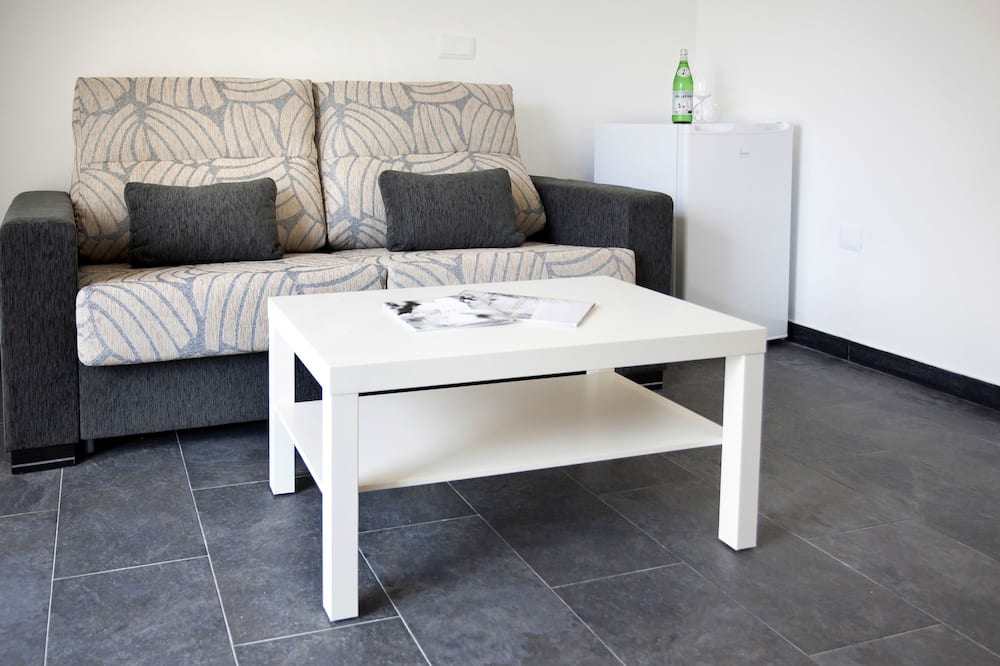 Deluxe Suite, Balcony - Living Area
