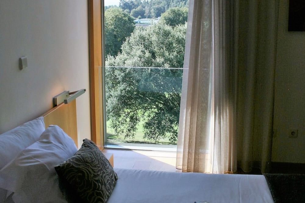 Двухместный номер с 1 или 2 кроватями, вид на поле для гольфа - Вид на сад