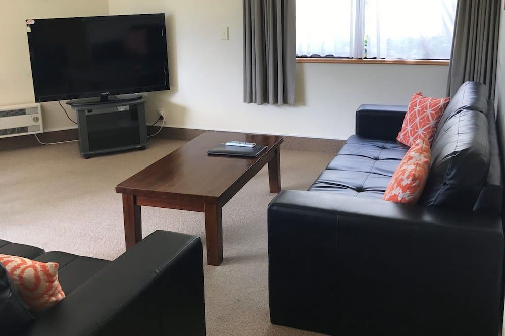Апартаменты, Несколько кроватей - Зона гостиной