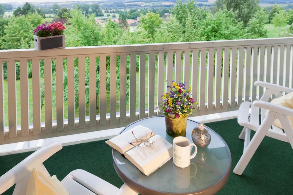 Suite, 1 Doppelbett, Kochnische (Cozy Sitting Corner) - Blick auf den Garten