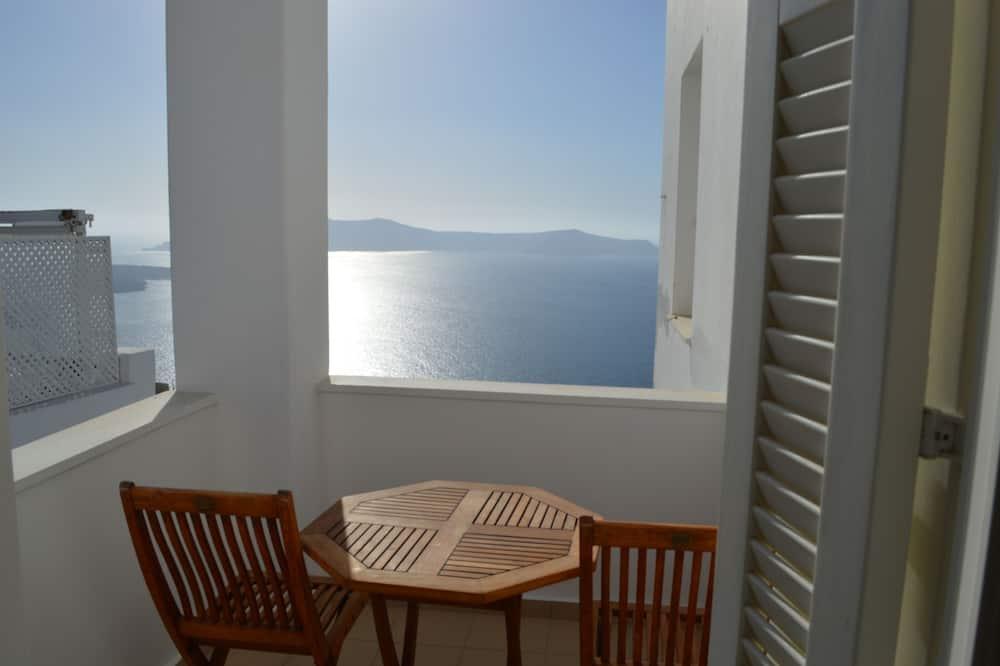 Habitación clásica con 1 cama doble o 2 individuales, balcón (Side Caldera View) - Vista al balcón