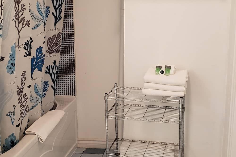 Suite junior, 1 cama King size con sofá cama - Baño